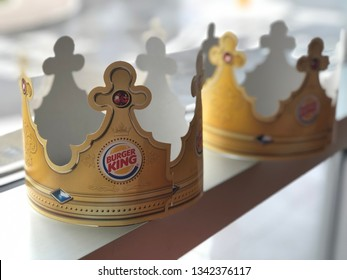 17.03.2019 Italy, Parma: Burger King paper crowns on the table