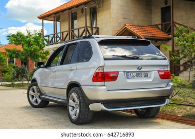 17.05.2017 Manavi, Kakheti, Georgia. BMW X5 E53 in front of manaveli wine factory Building