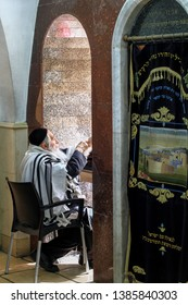 "17/3/2015 - Jewish rabbi is praying the morning pray at the synagogue in the northern Israeli town of Meron On the right written in Hebrew ""Our Lord opened the gates prayers"""