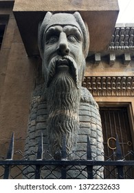 17-Apr-2019-Stone carved Lamassu sculpture a human headed winged bull on the base of Parsi Bomonjee Hormarjee Wadia Clock Tower (1880), Bazaar Gate Street, Fort MUMBAI Maharashtra INDIA