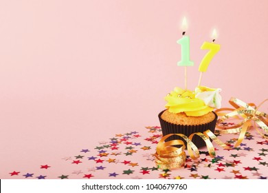 17th Birthday Cupcake With Candles Sprinkles And Ribbon On Pink Background Card Mockup