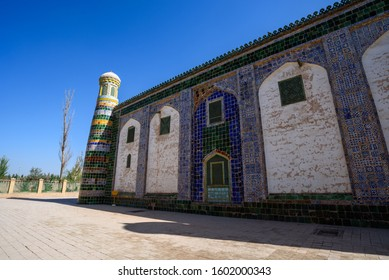 """17th century Abakh Khoja Tomb or Xiangfei in Kashgar, Xinjiang, China. Sign writes """"Object fall be careful"""" in uyghur and chinese."""