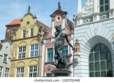 The 17th century Neptune fountain surrounded by historic buildings in Gdansk old town (Poland).