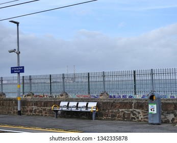 17th March 2019, Dublin, Ireland. Blackrock Dart Station with the Irish sea in the background.
