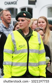 17th of May 2013 - Scene from the preparations for the Aalborg Carnival with close up of young female member of the home gurad in front of group of spectators, Aalborg, Denmark