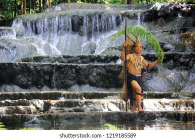17th, May, 2014 : Dayak men are hunting fish in the semolon waterfall, Malinau.
