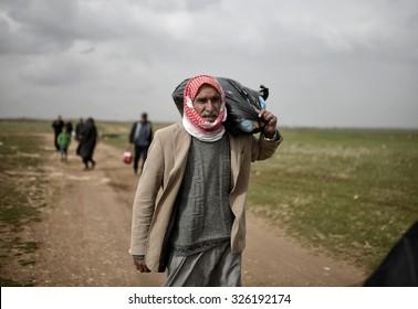 SANL?URFA,TURKEY, 18 FEBRUARY 2015 Syrian refugees walking on Turkey-Syria border in Suruc district.