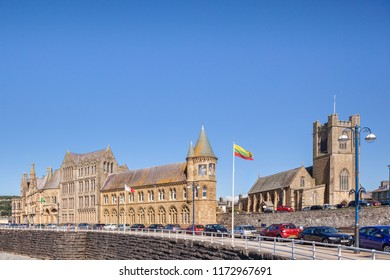 18 July 2016: Aberystwyth, Wales, UK - Old College, the original site of the University of Aberystwyth, and still part of the University, with St Michael's Church behind.