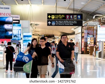 18 JUN 2019, Suvarnabhumi airport, Thailand, passengers walking at the shopping area, Duty free luxury brand name shops in  terminal departure, gate airline with VAT refund signage for tourists.
