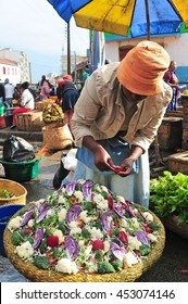 18 JUNE 2016â??Antananarivo, Madagascar. Vendor selling chopped vegetables at Analakely Market.