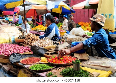 18 JUNE 2016â??Antananarivo, Madagascar. Vendor selling peppercorns, chillies, shallots, garlic and ginger at Analakely Market.