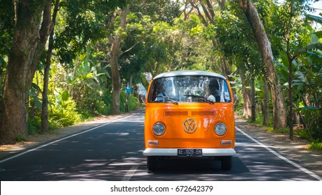 18 of march, 2017 - orange retro VW Bulli 1962 on the road, Bali, Indonesia. Vintage hippie van is vehicle of the high wave surfers