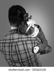 18 months old baby girl in her daddy's arms, studio shot.