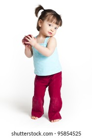 18 months old toddler holding an apple