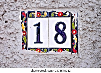 18, number eighteen, decorative numeral on white surface.