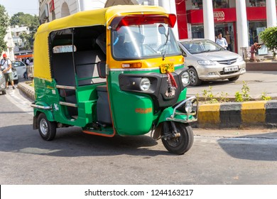 18 October 2018,Interior and taxi driver of so called Tuc Tuc rickshaw car in New Delhi, India