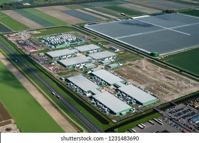 18 September 2018, Middenmeer, Holland. Aerial view of construction site for a new Microsoft datacenter. The huge building is located along highway A7 in the province NOORD HOLLAND.