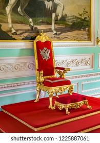 18 September 2018: Peterhof, St Petersburg, Russia - The coronation throne of Nicholas I in the Neoclassical Throne Room of Peterhof Palace.
