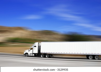 18 wheeler traveling on the highway