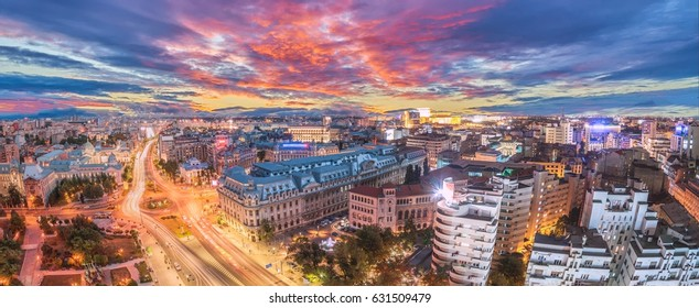 180 degrees panorama of traffic lights in the center of the capital city of Romania. Center of Bucharest at sunset. Romanian Parliament and University square.