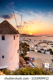 180 degrees sunset bar with windmill ,sunset from the hill of Mykonos Greece