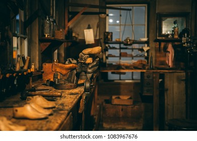 1800s era blacksmith and woodworking shop with vintage tools and wood projects