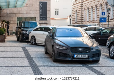 18.02.2019, Prague, The Czech Republic: Closeup of Jaguar in front of luxury hotel Four Seasons in Prague. Luxury cars in parking in front of Four Season hotel.