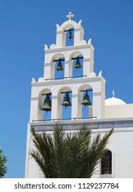 18.06.2015, Santorini, Greece: White church bell tower against blue sky.