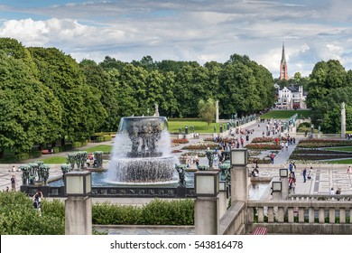 18.07.2016. Oslo, Norway.Locals and tourists enjoy sculptures created by Gustav Vigeland in Vigeland park, Oslo, Norway. This 80 acres large park features more than 200 sculpture.