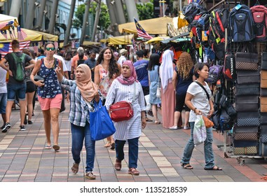 18.08.2017. mixed with local women with traditional clothes and western tourist women on the pedestrian streets and market in Kuala Lumpur, Malaysia