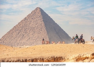 18/11/2018 Cairo, Egypt, guide with camels on the background of the pyramid
