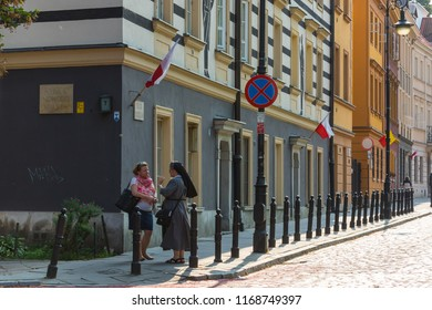 18/8/30 Warsaw Poland: Cobblestone New Town street decorated with flags