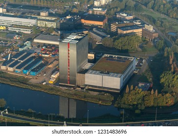 18-9-2018, Amsterdam, Holland. Aerial view of Equinix Datacenter. A skyscraper with no windows. The structure of the high rise building reflects in the water and gives a long early morning shadow.