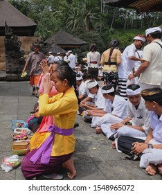 18th August 2017- Tampaksiring, Bali, Indonesia: Prayer during temple ceremony in Tirta Empul Temple