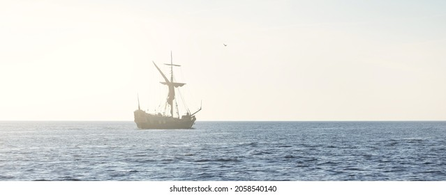 18th century sailing yacht in an open sea at sunset, close-up. Holland. Old tall ship. Recreation, vacations, cruise, historical reenactment, past, history