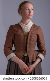 18th Century woman in brown ensemble