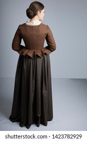 18th century woman in brown outfit