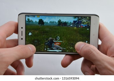 18th of Febuary. Ukraine, Kramatorsk. Playing on the smartphone Pubg G from the first person on a white background