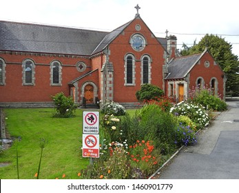 18th July 2019, Dublin, Ireland. Church inside The Convent of the Holy Faith grounds in Glasnevin, Dublin, with no dogs allowed and no cycling signs outside the building.