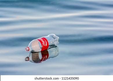 18th May 2018 Reflection of empty plastic bottle Coke floating in the ocean sea water