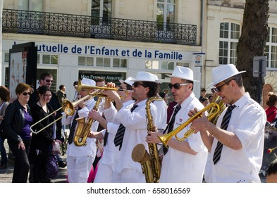 19 APRIL 2016 Editorial. The brass man band is playing on the street of Nantes during annual carnaval. Music festival 2016 France