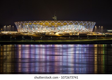 19 April, 2018 Volgograd, Russia. New football stadium Volgograd Arena with russian flag illumination in the night, view from the other side of the Volga river.