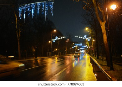 19 December 2017-Bucharest, Romania. The Victoria square from the capital city decorated with Christmas lights and traffic.