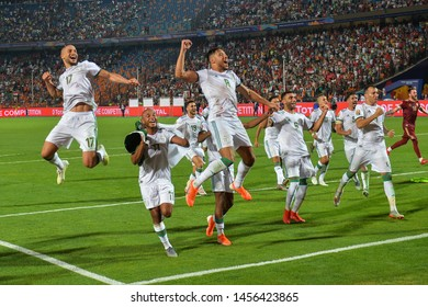 19 July 2019, Egypt, Cairo: Algeria players celebrate victory after winning the 2019 Africa Cup of Nations final soccer match between Senegal and Algeria at the Cairo International Stadium.
