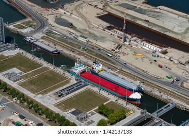 19 May 2020, Terneuzen, Holland. Aerial view of three freight ships in sluice in the canal Kanaal Gent Terneuzen in the province of Zeeland.