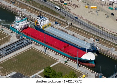 19 May 2020, Terneuzen, Holland. Aerial view of two freight ships in lock in the canal Kanaal Gent Terneuzen in the province of Zeeland.