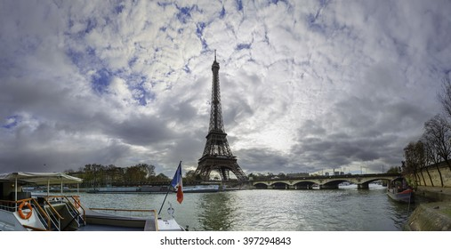 19 mpx panoramic view of the Eiffel Tower and Jena bridge from the river Seine embankment, Paris, France. Autumn.