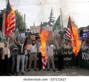 19 november 2010 turkey ?stanbul.  demanstrators  are protesting america and burning americann flags.