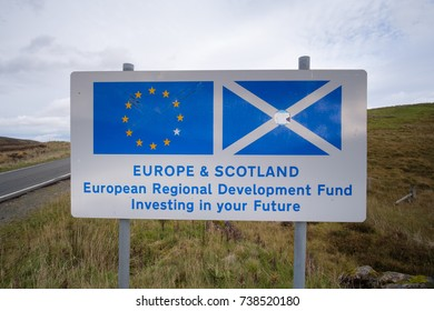 19. October 2017. 'Europe & Scotland, European Regional Development Found' sign with one of the stars scraped off. Isle of Skye, Scotland, UK
