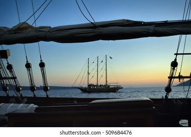 19 September 2016 Two sailing boats at sea in Santorini, Greece.